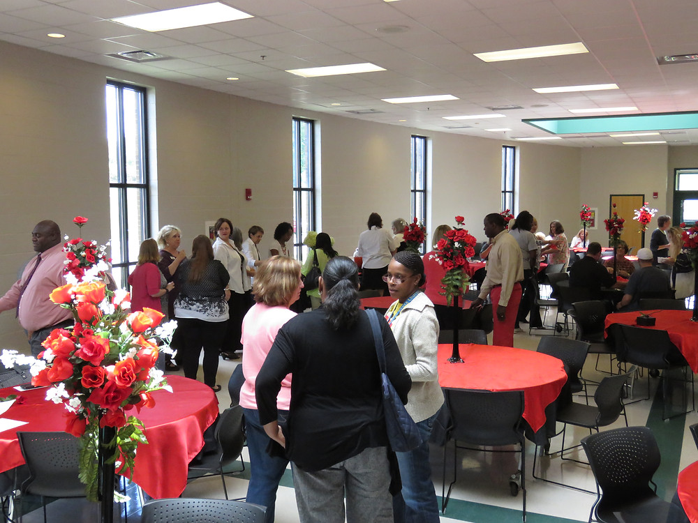 Guests enjoying the reception for retirees at the Baldwin High School Fine Arts Center.