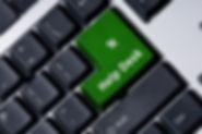Small earth sitting on a keyboard
