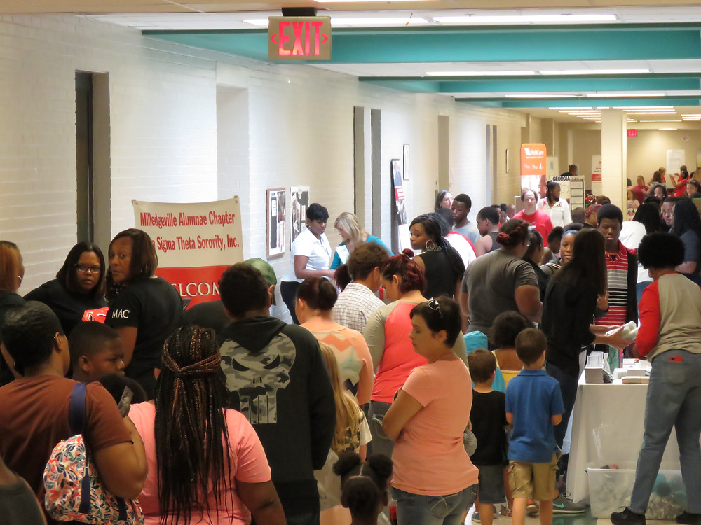 Families visiting during the 2018 Back to School Bash