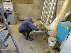 Annabel mixing morter.jpg
