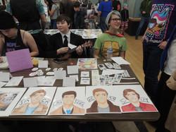 Several youths at display table