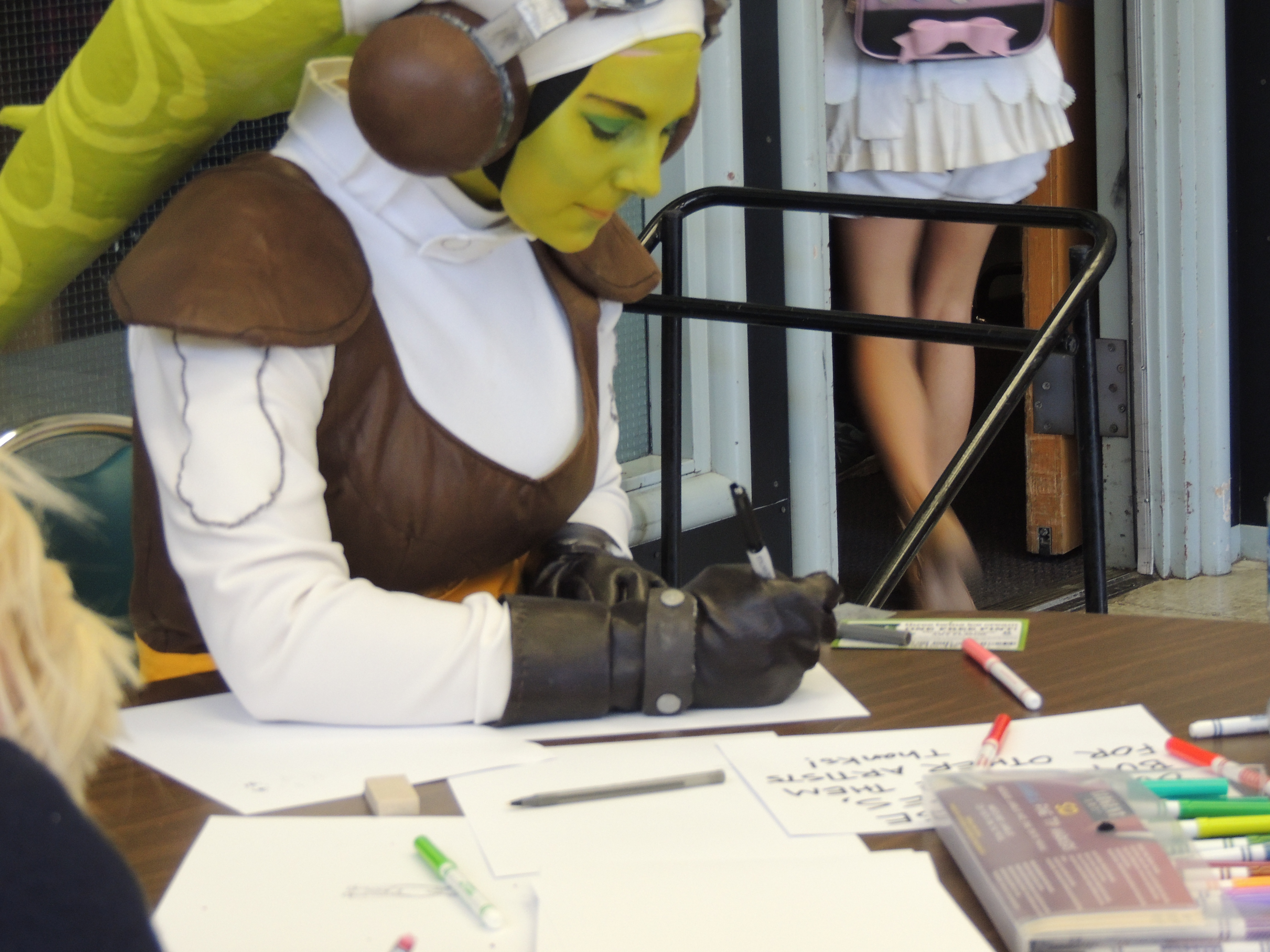 Cosplayers drawing
