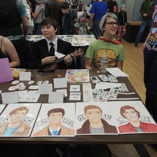 Youths at table with artwork
