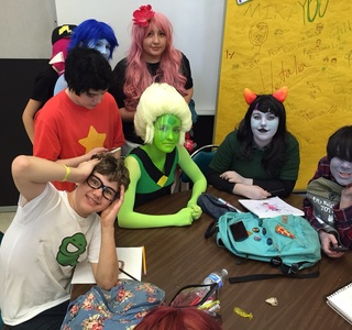 Cosplayers at craft table