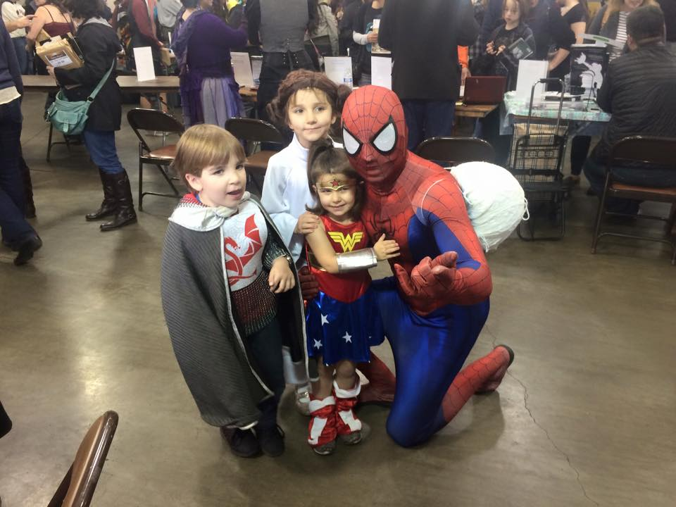 Children pose with Spiderman