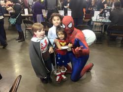 Children pose with Spiderman