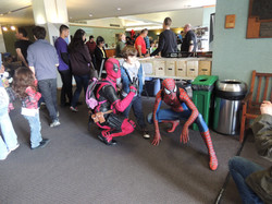 Deadpool and Spiderman posing in the lobby