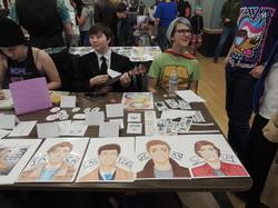 Youth at art table