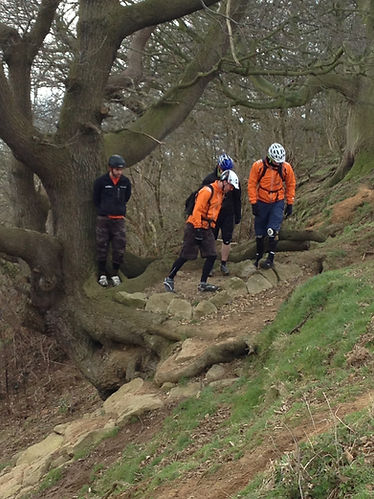 Men on mtb / cycle coaching session at Hadleigh Park. At Leap of Faith feature.