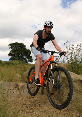 Man on mountain bike at Hadleigh Park. Mountain bike / cycle coaching session at home of the 2012 Olympics.