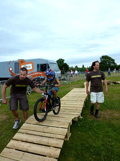 Get Out There MTB's portable bike obstacle course / North Shore-style track being used as event activity. Also available for hire / rental.