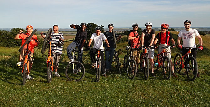 Group of men on a corporate mountain bike coaching session.