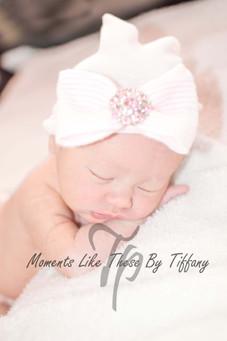 newborn with eyes closed