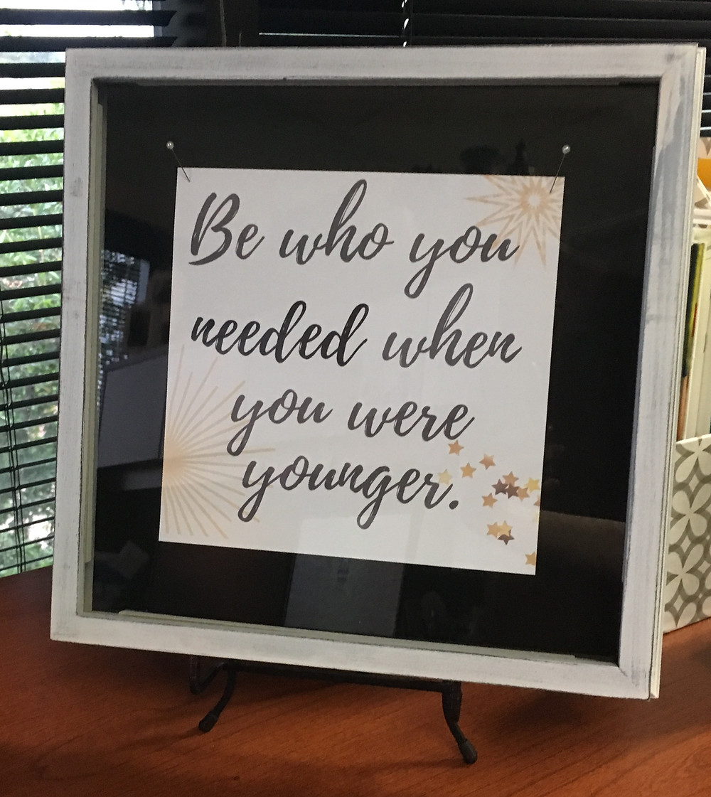 framed picture with quote inside