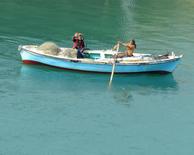 """Fishermen on the Suez Canal"""