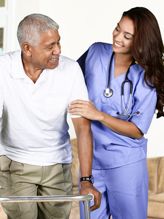 Health-care-worker-helping-an-95363420.j