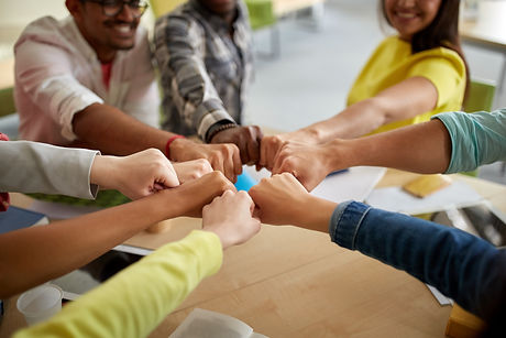 education, school, teamwork and people concept - close up of international students hands making fis