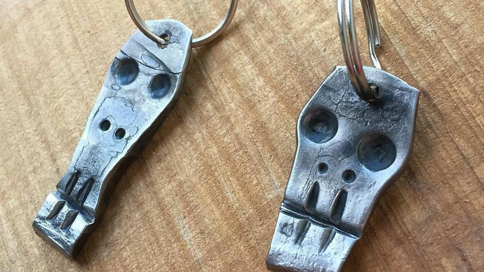 Hand forged skull keychain.