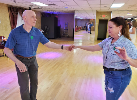 Leta and Doug show off their west coast swing dance moves!