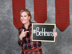 Shivaun Palmer, Co-Founder, DEI Consultants, LLC holding #BeHeard Sign - Plaid for Women event, Tarrant County College, Fort Worth, TX