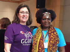 Cathy Holt, Co-Founder, DEI Consultants, LLC and Huairou Commission Governing Council Chair Violet Shivutse, celebrating the passage of new governance structure & bylaws of the organization.
