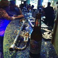 TrumpetOnTheBarWithBottleBeer.jpg