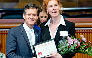 Carrie Davis receiving a 2015 Woman of Distinction Award from the New York State Senate in recognition of outstanding women living and working in New York whose contributions have greatly enriched the quality of life in their communities and beyond. With New York State Senator Brad Hoylman and Carrie Davis in Albany, NY.