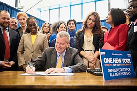 Mayor de Blasio signs his 2016 ground-breaking executive order protecting the right of every New Yorker to use City single-sex facilities consistent with their gender identity. With Corey Johnson, Carrie Davis, First Lady Chirlane McCray, Mayor Bill de Blasio, Bianey Garcia, Carmelyn P. Malalis and Sean Coleman and others in New York, NY.