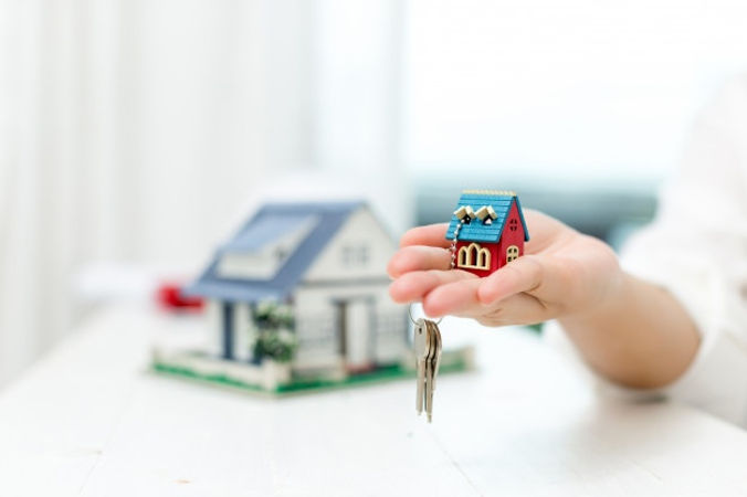 real-estate-agent-with-house-model-keys_