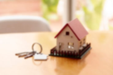 toy-model-house-concept-with-keys-blurre