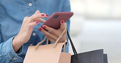 woman-use-of-mobile-phone-with-shopping-
