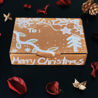 Turn your cardboard boxes into gift boxes this Christmas.