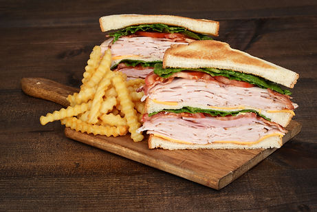 toasted chicken club sandwich with fries