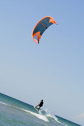 Kiteboarder enjoy surfing in the sea.jpg