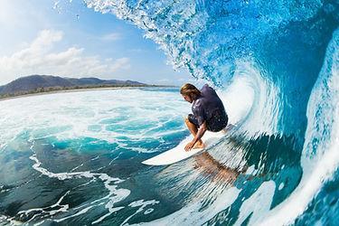 Surfer on Blue Ocean Wave in the Tube Ge