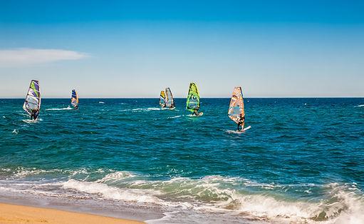 Wind surfers on the blue sea.jpg