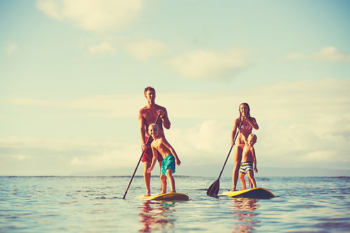 Family stand up paddling at sunrise, Sum