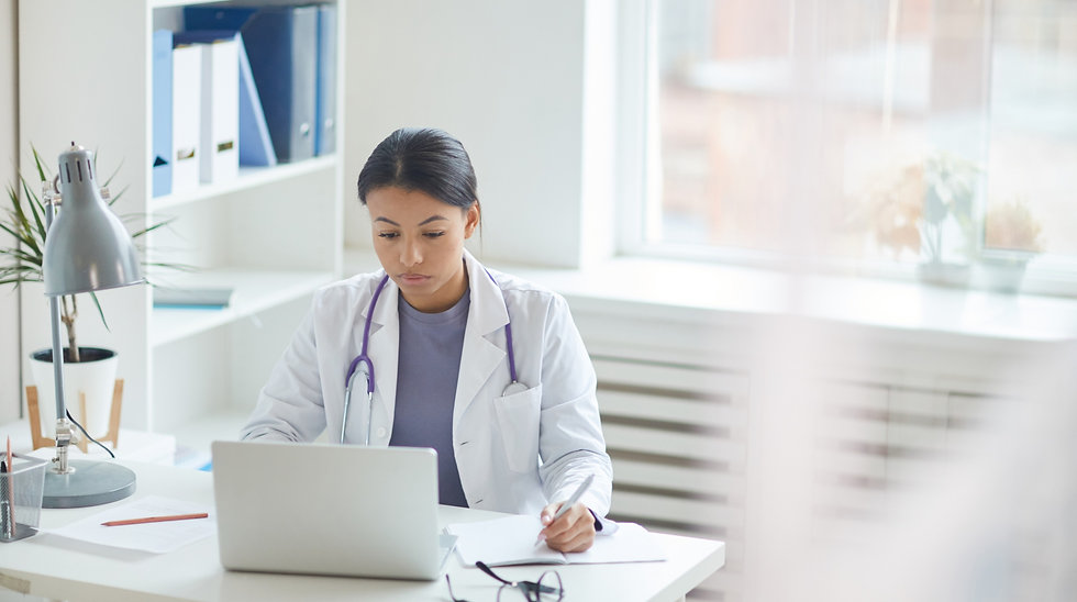 doctor-using-laptop-at-office-5URVVLG_ed