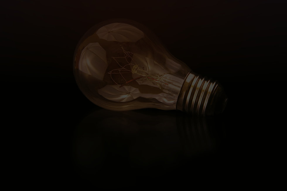 incandescent bulb on black surface_edited.jpg