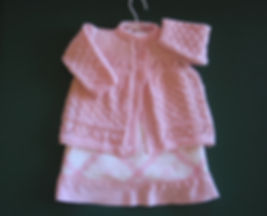 Lovely pink baby jacket hand-knitted using top quality Merino wool