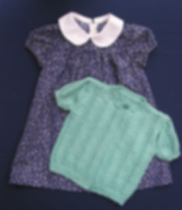 Hand-knitted baby cardigan                                                                                                                    Hand-knitted baby jade green patterned cardigan using top quality Merino wool