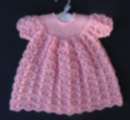 Beautiful hand-knitted pink lacey Merino wool baby dress