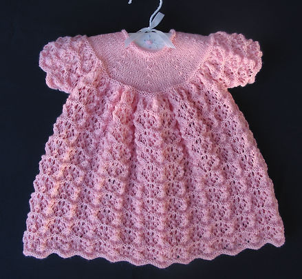 Beautiful hand-knitted pink lacey Merino wool baby dress