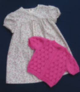 Mid pink short sleeved baby cardigan hand-knitted in top quality Merino wool