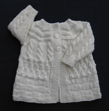 Hand-knitted baby multipatterned jacket in white baby Merino wool