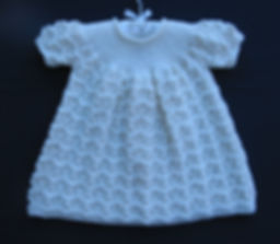 Luxury hand-knitted white christening dress for baby girl using sofr Merino wool