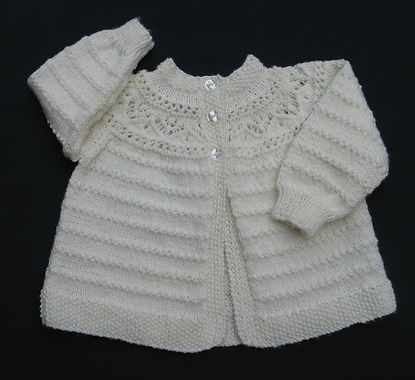 Hand knitted baby's jacket with lacy yoke in soft Merino wool