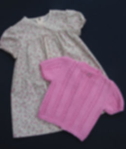 Babies hand-knitted pink short sleeved patterned cardigan knitted in top quality Merino wool