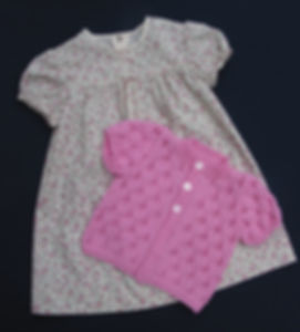 Pink short sleeved baby cardigan hand-knitted in high quality Merino wool