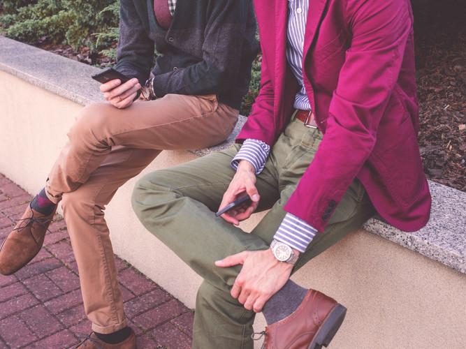 Canva - Stylish Adults Talking Outdoors.